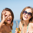 Stock Photo: Girls with drinks on beach chairs