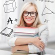 Student with stack of books and doodles — Stock Photo #29752165