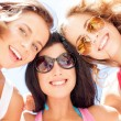 Girls faces with shades looking down — Stock Photo