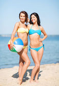 Girls with ball on the beach — Stock Photo