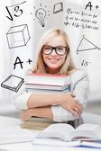 Student with stack of books and doodles — Stock Photo