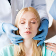Plastic surgeon or doctor with patient — Stock Photo #29791041