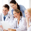Group of doctors looking at tablet pc — Stock Photo #29791053