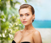 Woman wearing shiny diamond earrings — Stock Photo