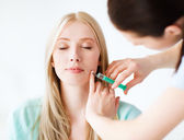 Beautician with patient doing botox injection — Stock Photo
