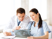 Two doctors looking at x-ray — Stock Photo