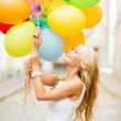Woman with colorful balloons — Stock Photo #29851643
