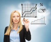 Businesswoman drawing graphs in the air — Stock Photo