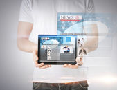 Man showing tablet pc with news — Stock Photo