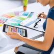 Stock Photo: Womworking with color samples for selection