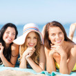 Girls sunbathing on the beach — Stock Photo #30058673