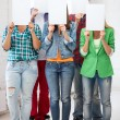 Students covering faces with blank papers — Stock Photo #30059121