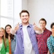 Student with group of students at school — Stock Photo