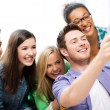 Students making picture with tablet pc at school — Stock Photo #30059523