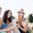 Girls with champagne glasses on boat — Stock Photo