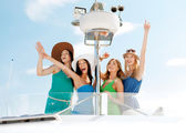 Girls waving on boat or yacht — Stock Photo