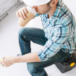 Builder drinking take away coffee — Stock Photo