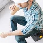 Builder drinking take away coffee — Stock Photo