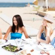 Girls in cafe on the beach — Stock Photo