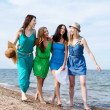 Girls walking on the beach — Stock Photo