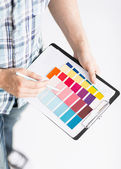 Man with color samples for selection — Stock Photo