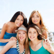 Group of girls in cafe on the beach — Stock Photo #30092335