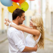 Couple with colorful balloons — Stock Photo #30161689