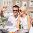 Couple taking photo in cafe — Stock Photo