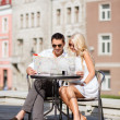 Couple with map in cafe — Stock Photo