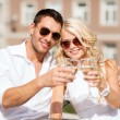 Couple drinking wine in cafe — Stock Photo
