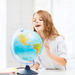 Student girl with globe at school — Stock Photo #30164059