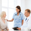 Doctor with patient in hospital — Stock Photo
