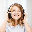 Little girl with headphones at home — Stock Photo #30214147