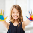 Girl showing painted hands — Stock Photo