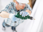 Man drilling the wall — Stock Photo