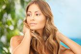 Beautiful woman with long hair — Stock Photo