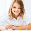Little girl painting at school — Stock Photo #30226789