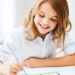 Little girl painting at school — Stock Photo #30231109