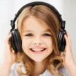 Little girl with headphones at home — Stock Photo #30407215