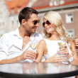Couple drinking wine in cafe — Stock Photo #30407333