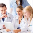 Group of doctors looking at tablet pc — Stock Photo #30407657