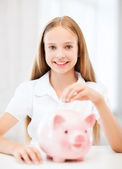 Child with piggy bank — Stock Photo