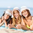Girls sunbathing on the beach — Stock Photo #30458265