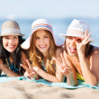 Girls sunbathing on the beach — Stock Photo #30458285