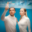 Man and woman working with virtual screen — Stock Photo #30511033