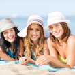 Girls sunbathing on the beach — Stock Photo #30511315