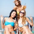 Girls with drinks on the beach chairs — Stock Photo #30511351