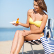 Girl sunbathing on the beach chair — Foto Stock
