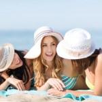 Girls sunbathing on the beach — Stock Photo