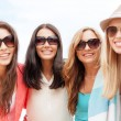 Girls in shades having fun on the beach — Stockfoto